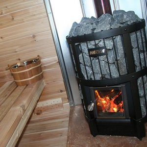 Wood burning heaters for sauna bathes